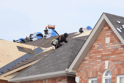Roofer Installing Shingled Roof